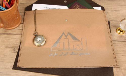 پوشه دکمه دار تبلیغاتی پارچه ای با چاپ طلاکوب